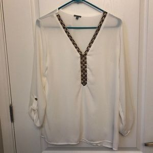 White blouse with embellished neckline